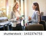 two businesswomen talking... | Shutterstock . vector #1432376753