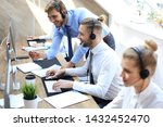 Small photo of Phone operator working at call centre office helping hiss colleague.