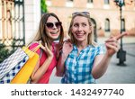 women in shopping. two happy... | Shutterstock . vector #1432497740
