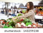 young woman picking vegetables... | Shutterstock . vector #143259238