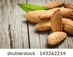 almonds with leaf on wooden...   Shutterstock . vector #143262214