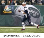 Small photo of EAST RUTHERFORD, NJ - NOV 22: New England Patriots quarterback Tom Brady (12) looks to pass the ball against the New York Jets at MetLife Stadium on November 22, 2012 in East Rutherford, New Jersey.