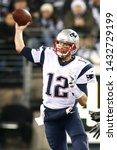 Small photo of EAST RUTHERFORD, NJ - NOV 22: New England Patriots quarterback Tom Brady (12) throws the ball against the New York Jets at MetLife Stadium on November 22, 2012 in East Rutherford, New Jersey.
