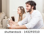 young couple playing video... | Shutterstock . vector #143293510