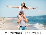 happy couple having fun on the... | Shutterstock . vector #143294014
