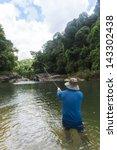 fly fishing angler makes cast... | Shutterstock . vector #143302438