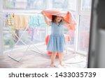 Little Girl In Laundry Room....