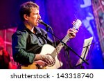 musician plays a guitar on stage - stock photo
