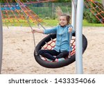 happy teen girl on swing in... | Shutterstock . vector #1433354066