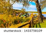 Small photo of Autumn village fence view. Autumn village landscape. Wooden fence in autumn village. Autumn village view