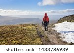 A Hiker Walking Down From The...