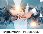 Small photo of Double exposure Business people of Marketing team with a Partnership greeting power tag team,Teamwork Join Hands Partnership Concept after complete deal,Successful Teamwork Partnership in the city.