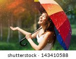 laughing woman with umbrella... | Shutterstock . vector #143410588