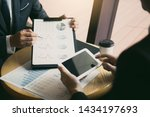 managers are using tablets to... | Shutterstock . vector #1434197693