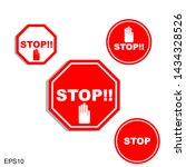 red stop sign on white...