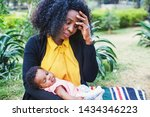 Sad African Woman Holding Her...