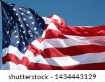 American Flag Against A Blue...