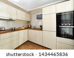 Stock photo white kitchen interior counter top wooden top background of kitchen 1434465836