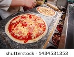 cooking pizza in the cafe.... | Shutterstock . vector #1434531353