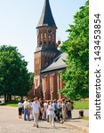 KALININGRAD, RUSSIA - JUNE 24: A group of tourists at the wall of the Kant`s cathedral on june 24, 2013 in Kaliningrad, Russia. - stock photo