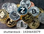 Crypto currency background with various of shiny silver and golden physical cryptocurrencies symbol coins, Bitcoin, Ethereum, Litecoin, zcash, ripple. - stock photo
