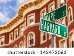 Stock photo harvard street sign with a classic red brick building in the background location harvard 143473063