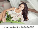 Woman With Beautiful Flowers I...