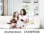 cheerful mother and daughter... | Shutterstock . vector #143489038