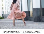 Pleated skirt coral color and...