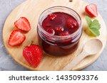 strawberry jam in a glass jar... | Shutterstock . vector #1435093376