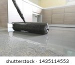 Small photo of Self-leveling epoxy with needle roller. Leveling with a mixture of cement floors.Needle roller for bulk floor.Epoxy Concept.