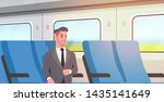 Businessman Traveling By Train...
