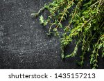 Sprigs Of Fresh Thyme. On Dark...