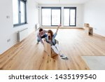 Young Couple In New Empty Room. ...