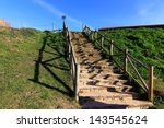 stairs to the beach with wooden ... | Shutterstock . vector #143545624