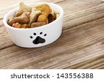 Dog Food In A Bowl On Wooden...