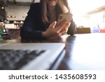close up of a woman using... | Shutterstock . vector #1435608593