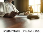 lawyer working on the table in... | Shutterstock . vector #1435613156