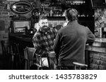 men relaxing in pub. weekend... | Shutterstock . vector #1435783829