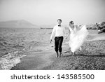 a wedding by the sea. honeymoon.... | Shutterstock . vector #143585500