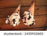 ice cream in cones on a wooden... | Shutterstock . vector #1435910603