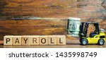 Small photo of Wooden blocks with the word Payroll, money and a forklift. Payroll is the sum total of all compensation a business must pay to its employees for a set period of time or on a given date. Taxes.