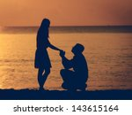 man knees ask woman to marry | Shutterstock . vector #143615164