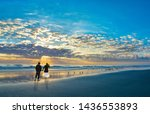 Couple Walking On Beach At...