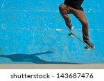 Skateboarder Doing A Skateboar...