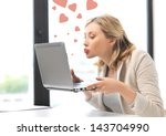 picture of woman with laptop... | Shutterstock . vector #143704990