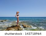 beautiful woman on the beach | Shutterstock . vector #143718964