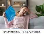 overheated millennial woman sit ... | Shutterstock . vector #1437249086