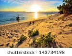 Stock photo romantic happy couple enjoying a beautiful sunset on the beach 143734198