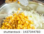 adding canned corn from a jar...